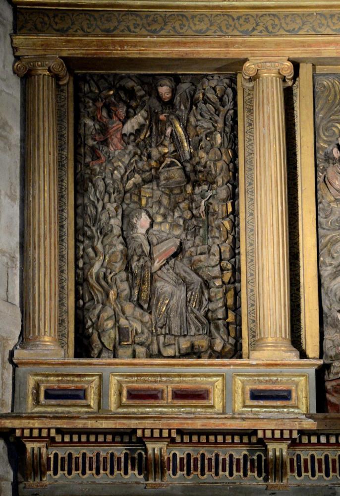 Retablo mayor de la iglesia de San Salvador de Cornellana. San Benito recibe la comida que le baja el monje Román en la cueva de Subiaco.